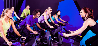 Indoor Cycling instructor leading indoor cycling participants.