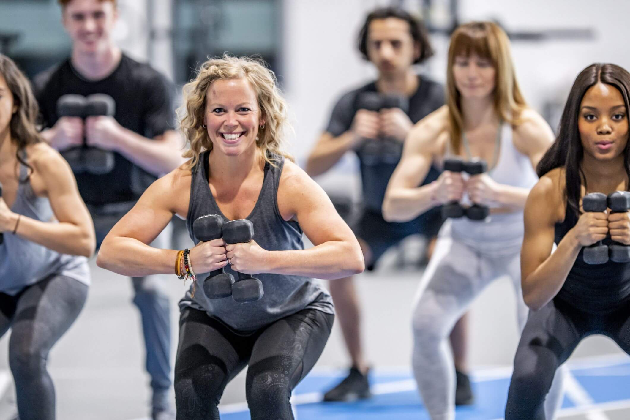 Woman Attending Group Fitness class lead by an AFAA Certified Instructor